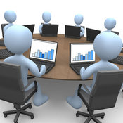 Royalty Free Stock Illustration of a Group of Blue Men or Employees in a Training Class, Using Laptop Computers to View Charts and Graphs While Seated Around a Conference Table by 3poD